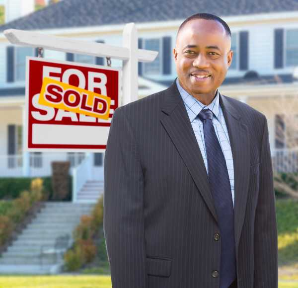real estate agent with sold house